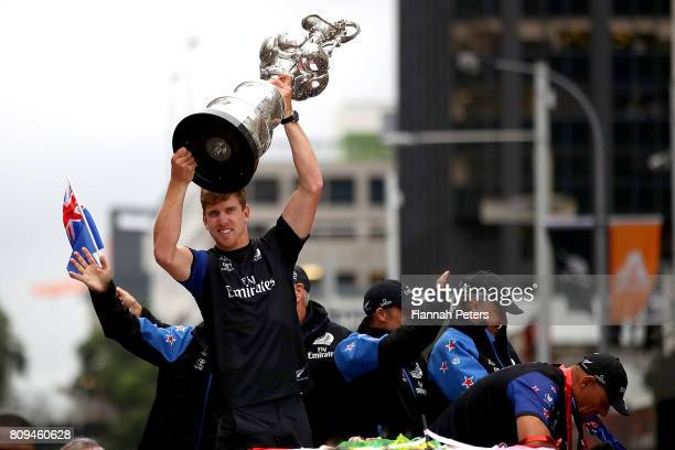 Peter Burling of Team New Zealand holds the Americas Cup aloft during the Team New Zealand Americas Cup Welcome Home Parade on July 6 2017 in...