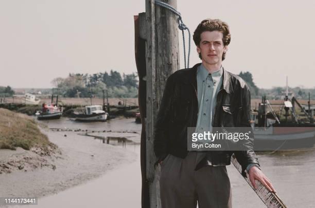 Peter Capaldi, a Scottish actor at Thornham Harbour after taking a break from filming in the village of Thornham, North Norfolk, U.K., Circa 1990.