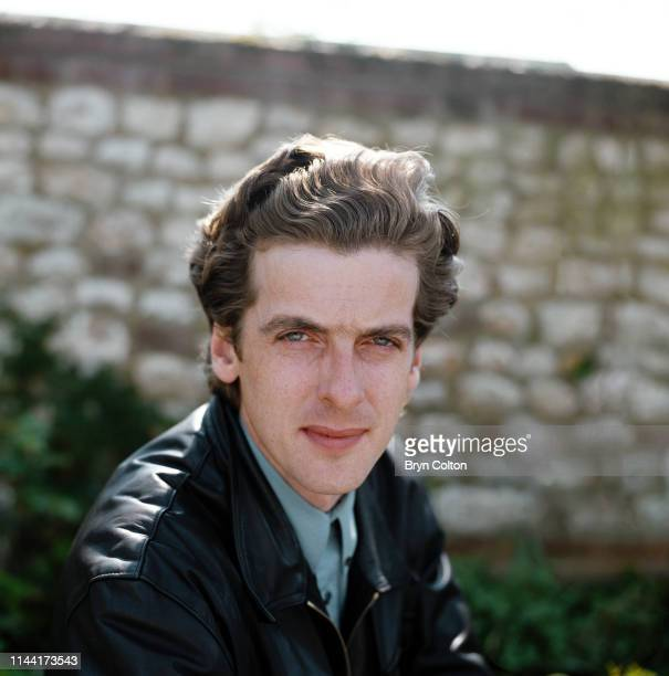Peter Capaldi, a Scottish actor takes a break from filming in the village of Thornham, North Norfolk, U.K., Circa 1990.