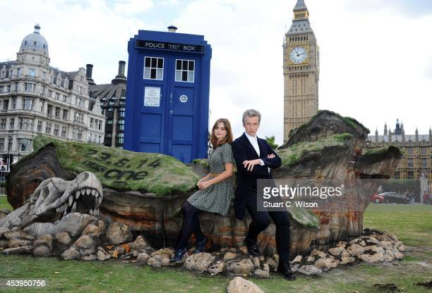 Peter Capaldi and Jenna Coleman attend a photocall ahead of the new BBC series of 'Dr Who' in Parliament Square on August 22 2014 in London England