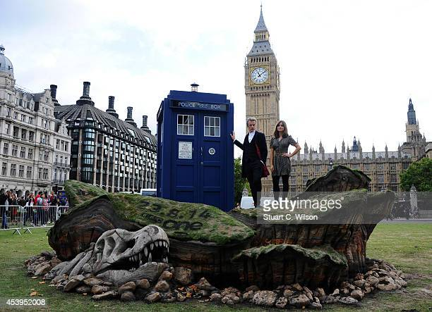"""Peter Capaldi and Jenna Coleman attend a photocall ahead of the new BBC series of """"Dr Who"""" in Parliament Square on August 22, 2014 in London, England."""