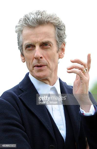 Peter Capaldi attends a photocall ahead of the new BBC series of 'Dr Who' in Parliament Square on August 22 2014 in London England