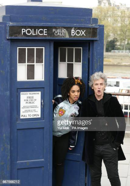 Peter Capaldi in costume as Doctor Who and Pearl Mackie as his new companion Bill Potts pose with a replica of the TARDIS alongside a 3D alien...