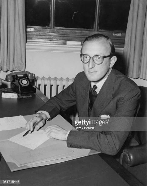 Peter Carington Lord Carrington the newlyappointed Parliamentary Secretary to the Minister of Defence at his new desk at the Ministry of Defence in...