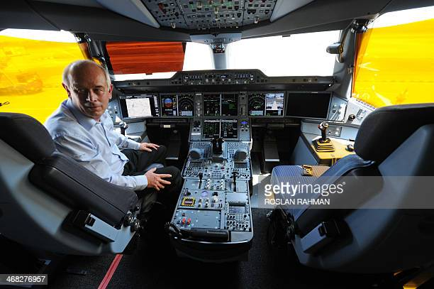 Peter Chanddler Airbus chief test pilot engineering flight operation sits inside the cockpit of an Airbus A350900 during a media preview at Changi...