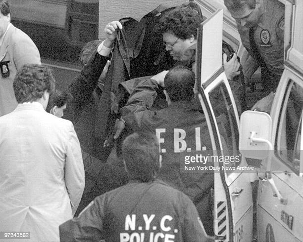 Peter Chioda is covered up by authorities as he leaves ambulance to testify against Gotti family Chioda was shot 12 times in a rubout attempt