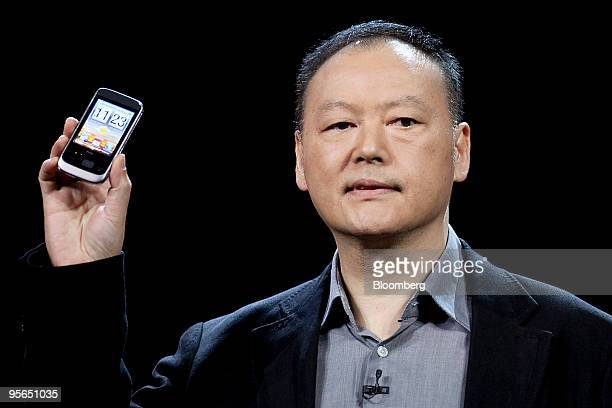 Peter Chou chairman of HTC Corp holds up the new HTC Smart mobile phone during the 2010 International Consumer Electronics Show in Las Vegas Nevada...