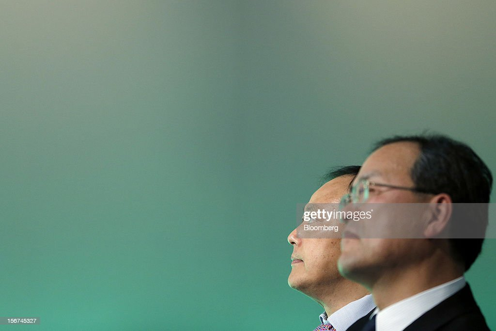 Peter Chou, chief executive officer of HTC Corp., left, stands with Takashi Tanaka, president of KDDI Corp., during the launch of the HTC J Butterfly smartphone at an event in Tokyo, Japan, on Tuesday, Nov. 20, 2012. Taiwan's HTC Corp. needs to improve its global brand awareness to gain share in China, and its newly unveiled model is likely to help the vendor do that. Photographer: Kiyoshi Ota/Bloomberg via Getty Images