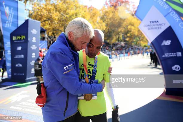 Peter Ciacciarace director of the New York City Marathon embraces Meb Keflezighi after he crossed the finish line during the 2018 TCS New York City...