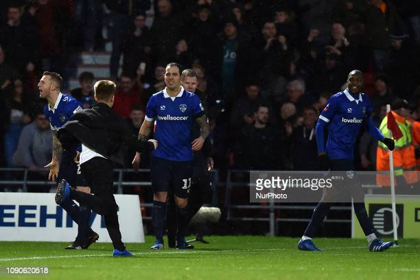 Peter Clarke of Oldham celebrates after scoring their first goal during the FA Cup match between Doncaster Rovers and Oldham Athletic at the Keepmoat...