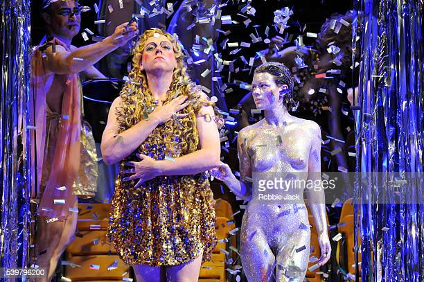 Peter ColemanWright as Caligula and an actress playing Drusilla with artists of the company in English National Opera's production of Detlev...