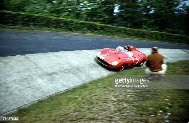 Peter Collins wheels the 335 Sport Ferrari which he shared with Olivier Gendebien through the 'ditch' of the Karussel on the way to second place in...