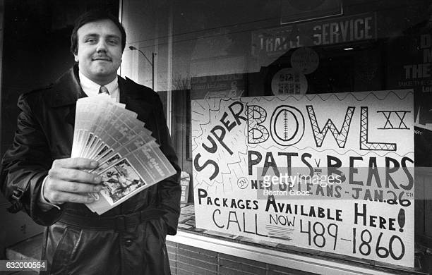 Peter Coloyan holds up New Orleans brochures in front of a travel agency in Belmont, Mass., on Jan. 15, 1986. The New England Patriots are playing...