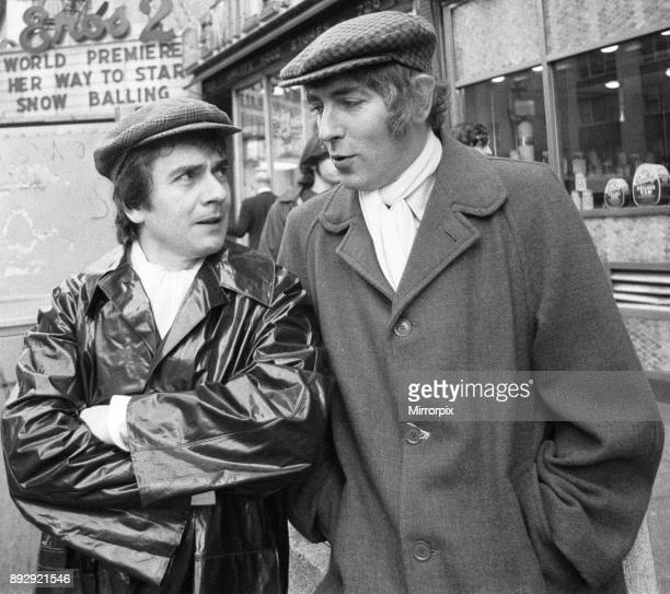 Peter Cook and Dudley Moore in their 'Pete and Dud' costumes on the corner of 7th Avenue and 45th Street New York They are appearing in the...