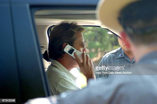 Peter Cook stops to ask state police to keep photographers at bay during ride to parents home Cook and his wife Christie Brinkley separated earlier...
