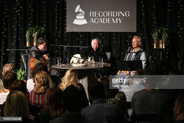 Peter Cooper singersongwriter John Prine and actor Bill Murray speak during The Recording Academy's Up Close And Personal With John Prine And Bill...