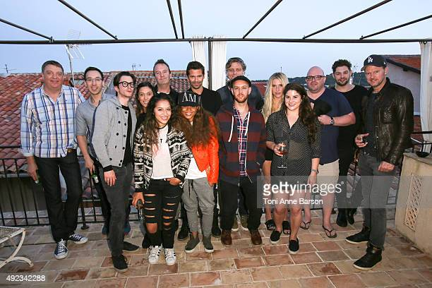 Peter Coquillard Founder of The Invitational Group surrounded by guests and among them Kesha Singer Songwriter Tessa Schonder Keshas Manager Sacha...