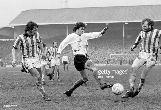 Peter Cormack of Liverpool takes on the Stoke City defence during their Division One match at the Victoria Ground Stoke on Trent on 31st March 1975...
