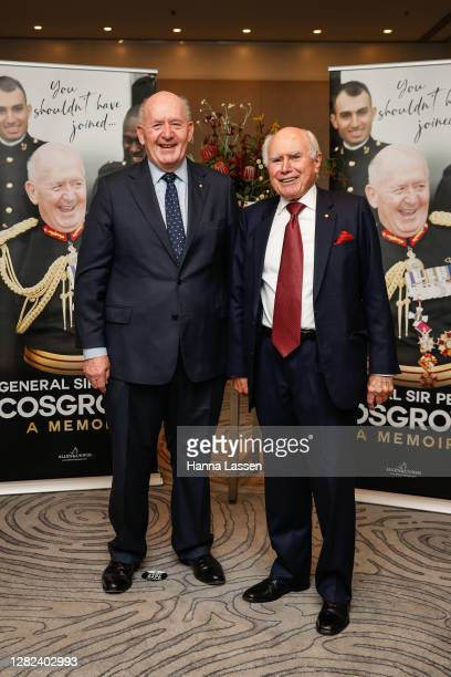 Peter Cosgrove, Former Governor-General of Australia and John Howard, Former Prime Minister of Australia pose during the launch of General Sir Peter...
