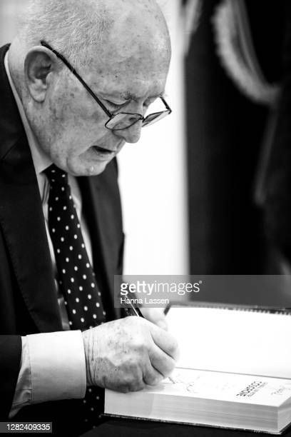 Peter Cosgrove, Former Governor-General of Australia signing on his book during the launch of General Sir Peter Cosgrove's book 'You Shouldn't Have...