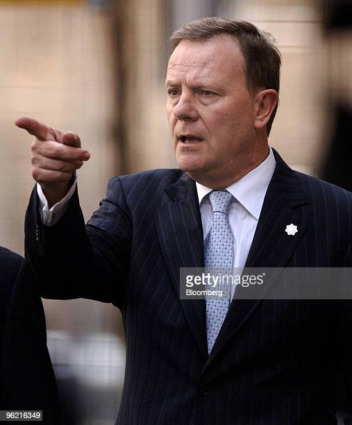 Peter Costello Australia's treasurer points as he walks close to the media on day five of the AsiaPacific Economic Cooperation meeting in Sydney...