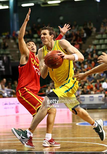Peter Crawford of the Boomers drives to the basket against Wei Liu of China during game one of the international friendly series between the...