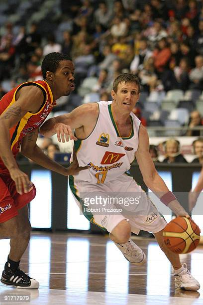Peter Crawford of the Crocodiles drives to the basket during the round three NBL match between the Melbourne Tigers and the Townsville Crocodiles on...