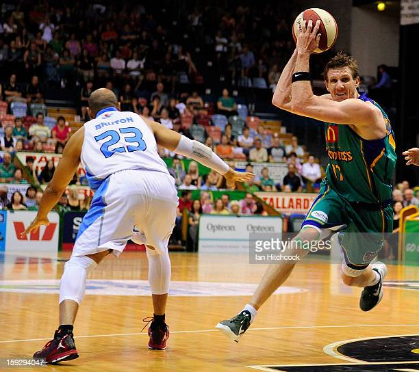 Peter Crawford of the Crocodiles drives to the basket past CJ Bruton of the Breakers during the round 14 NBL match between the Townsville Crocodiles...