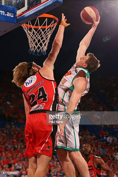 Peter Crawford of the Crocodiles dunks the ball against Jesse Wagstaff of the Wildcats during the round 21 NBL match between the Perth Wildcats and...