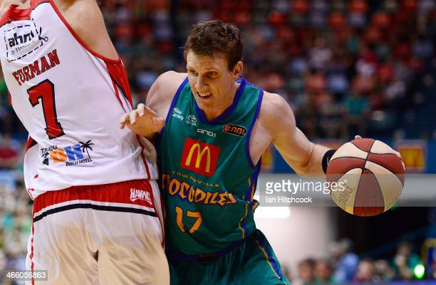 Peter Crawford of the Crocodiles looks to get past Oscar Forman of the Hawks during the round 16 NBL match between the Townsville Crocodiles and the...