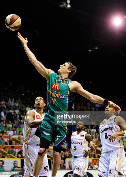 Peter Crawford of the Crocodiles makes a layup during the round two NBL match between the Townsville Crocodiles and the Cairns Taipans at Townsville...