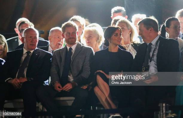 Peter Crosgrove, Prince Harry, Duke of SussexÊandÊMeghan, Duchess of Sussex seated watching during the Invictus Games Sydney 2018 Opening Ceremony at...