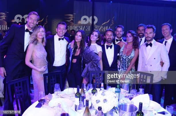 Peter Crouch Abbey Clancy guest Lily Fortescue Amy Jackson Jay Rutland Jamie Redknapp Jessica Lemarie Robert Pires Luke Sweeney and guest attend the...