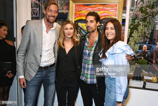Peter Crouch Abbey Clancy Hugo Taylor and Lisa Snowdon attend a VIP private view for New York artist Bradley Theodore at Maddox Gallery on April 19...