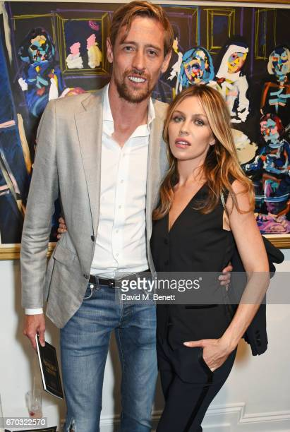 Peter Crouch and Abbey Clancy attend a VIP private view for New York artist Bradley Theodore at Maddox Gallery on April 19 2017 in London England
