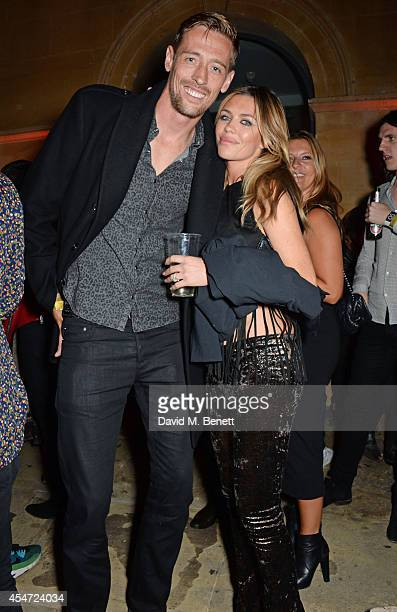 Peter Crouch and Abbey Clancy attend the Soho House event to celebrate Kasabian's performance at the iTunes Festival London on September 5 2014 in...