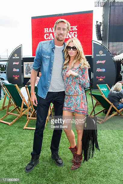 Peter Crouch and Abbey Clancy back stage on Day 1 of Hard Rock Calling 2013 at Queen Elizabeth Olympic Park on June 29 2013 in London England