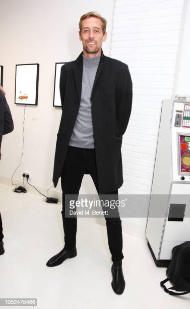 Peter Crouch attends a private view of Daft Apeth by Serge Pizzorno of Kasabian at No Ho Showrooms on October 18 2018 in London England