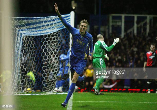 Peter Crouch celebrates scoring Portsmouth's first goal against Rovers during the Barclays Premier League match between Portsmouth and Blackburn...