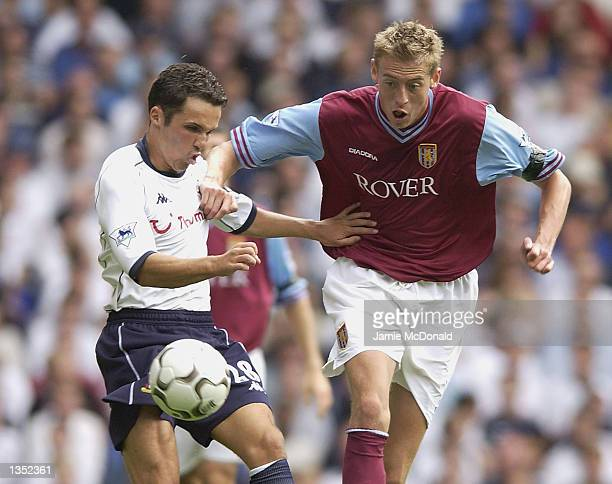 Peter Crouch of Aston Villa tries to tackle Matthew Etherington of Tottenham Hotspur during the FA Barclaycard Premiership match between Tottenham...