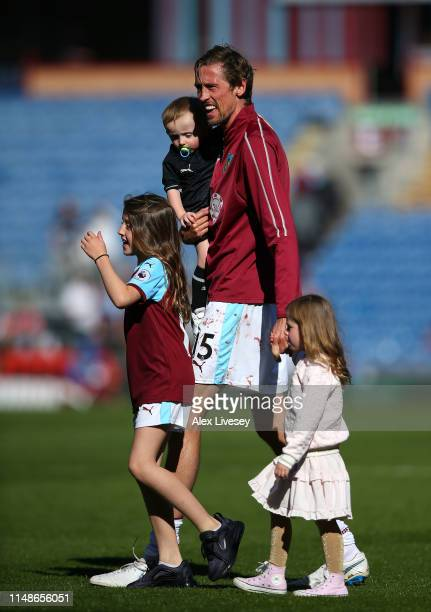 Peter Crouch of Burnley is seen with his children after the Premier League match between Burnley FC and Arsenal FC at Turf Moor on May 12 2019 in...