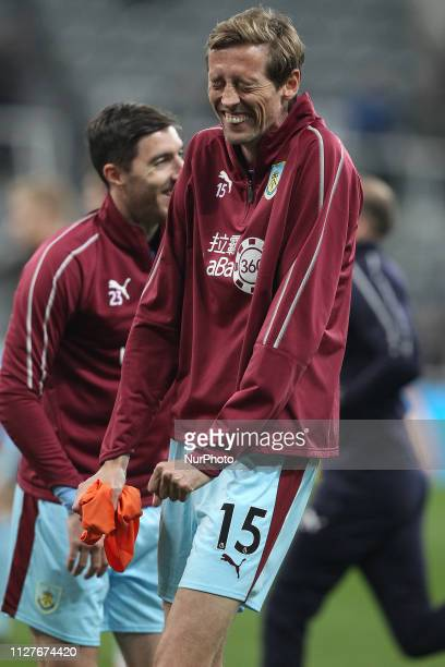 Peter Crouch of Burnley shares a joke with his team mates during the warm up before the Premier League match between Newcastle United and Burnley at...