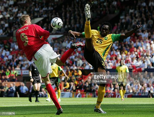 Peter Crouch of England and Jamaica's Claude Davis compete for the ball during the International Friendly between England and Jamaica at Old Trafford...