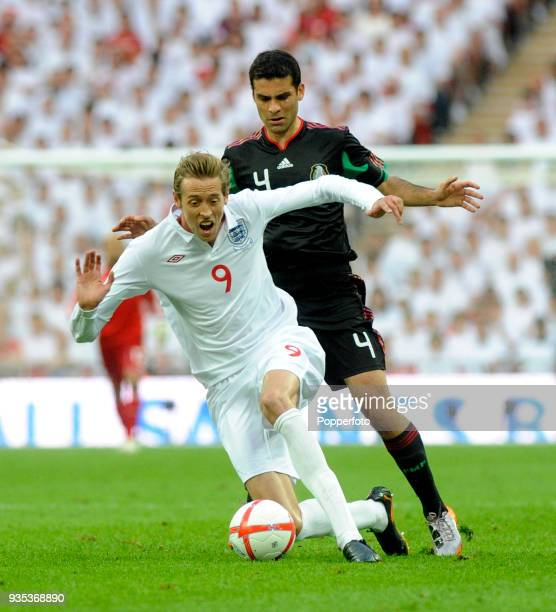 Peter Crouch of England and Rafael Marquez of Mexico in action during the International Friendly match between England and Mexico at Wembley Stadium...