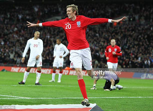 Peter Crouch of England celebrates as he scores their first goal during the International Friendly match between England and Egypt at Wembley Stadium...