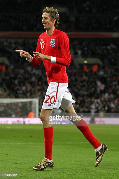 Peter Crouch of England celebrates as he scores their third goal during the International Friendly match between England and Egypt at Wembley Stadium...