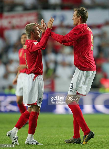 Peter Crouch of England celebrates his goal with David Beckham during the Euro 2008 qualifying match between Estonia and England at the ALe Coq Arena...