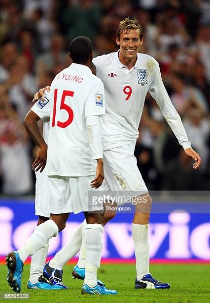 Peter Crouch of England celebrates scoring the 6th goal of the game with Ashley Young and Jermain Defoe during the FIFA 2010 World Cup Group 6...