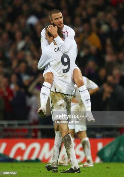 Peter Crouch of England celebrates with David Beckham after scoring England's 2nd and the equalising goal during the Euro 2008 Group E qualifying...