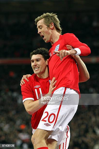 Peter Crouch of England celebrates with Gareth Barry as he scores their first goal during the International Friendly match between England and Egypt...